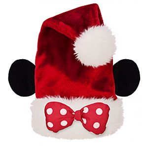 Plush Minnie ears and pretty polka dot bow adorn a furry Santa hat to ...